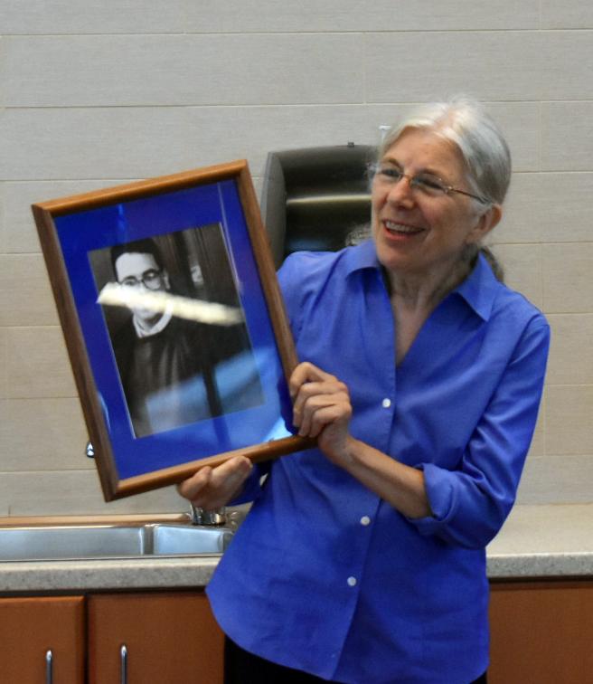 Nancy shows Leon's HS. photo